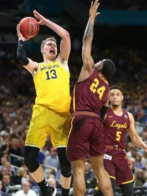 Michigan forward Moritz Wagner shoots over Loyola-Chicago forward Aundre Jackson during the Final Four on Saturday, March 31, 2018, at the Alamodome in San Antonio.