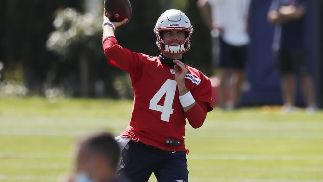 Patriots quarterback Jarrett Stidham fires a pass during an NFL football training camp on Friday, Aug. 21. Stidham has a hip injury which limited him in practice.