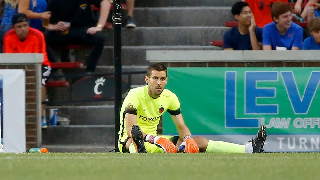 FC Cincinnati Mitch Hildebrandt (1) stays on the ground after allowing the go-ahead goal in the second half of the USL soccer match between FC Cincinnati and Orlando City B at Nippert Stadium in Cincinnati on Saturday, Aug. 5, 2017. Despite a goal late in stoppage time, FC Cincinnati settled for a tie against OCB.