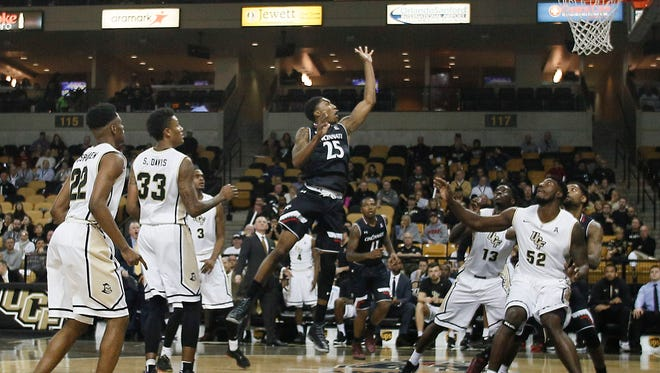 Cincinnati Bearcats guard Kevin Johnson (25) leaps from the foul line to shoot during the first half of a basketball game against the Central Florida Knights at CFE Federal Credit Union Arena.