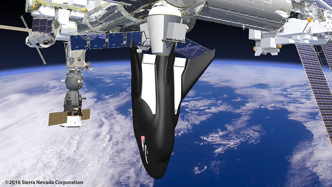Artist rendering of a Sierra Nevada Corp. Dream Chaser cargo spacecraft docked to the International Space Station.