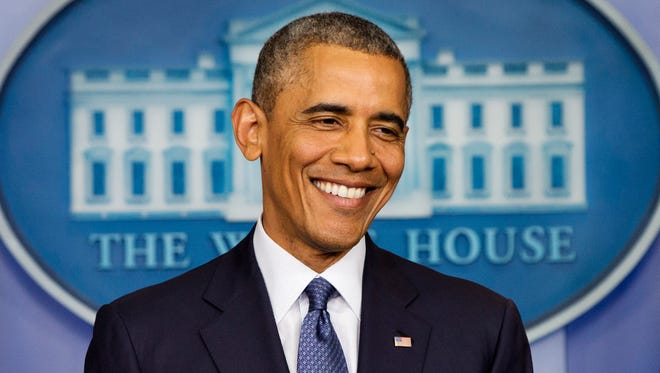 This Aug. 1, 2014, photo shows President Barack Obama as he smiles near the conclusion of a news conference in the Brady Press Briefing Room of the White House in Washington, on Aug. 1, 2014