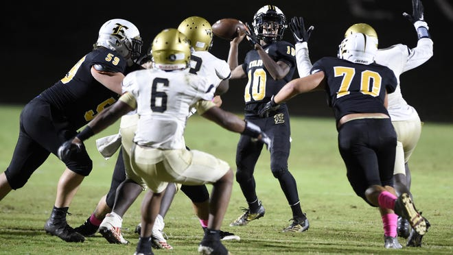 Evans quarterback Caleb Jackson is under pressure as he looks to pass during football action at Evans High School in Evans, Ga., Friday evening October 2, 2020.