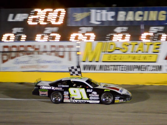 "Ty Majeski celebrates with an Alan Kulwicki-style ""Polish"