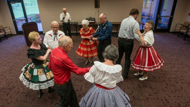 Wayne Nicholson, who is celebrating 70 years of square dance calling, calls for a group of dancers from different clubs in the River Region on Monday, July 18, 2016, at the Montgomery Advertiser building.
