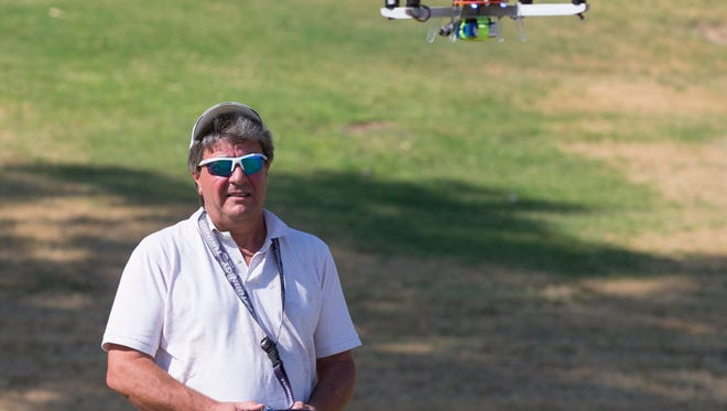 Mike Parker, owner of Arizona Technology Group, Inc. flies his drone at Thude Park  in Chandler on June 26, 2015.