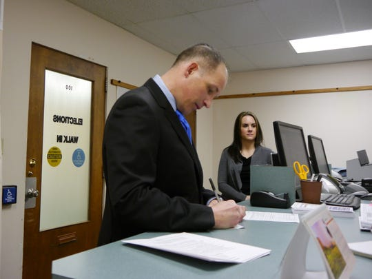Det. Jesse Slaughter of the Great Falls Police Department files for Cascade County Sheriff as his wife, Christie, looks on.