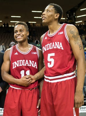 Hoosiers guard Yogi Ferrell (11) and forward Troy Williams (5) celebrate after the game against the Iowa Hawkeyes at Carver-Hawkeye Arena.