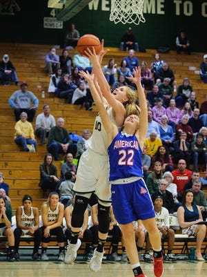 Catamount forward Hanna Crymble, left, battles for the rebound  in a women's basketball game earlier this season.