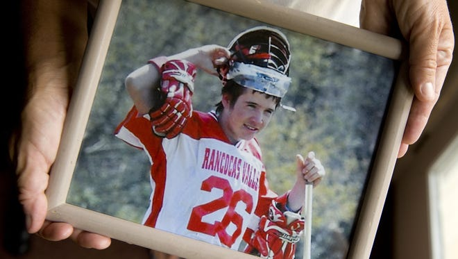 Patty Green of Lumberton holds a photo of her son, Nicholas, who died in 2012 at age 15. The fourth annual Nicky's Run will raise awareness about teen suicide and helps fund scholarships.