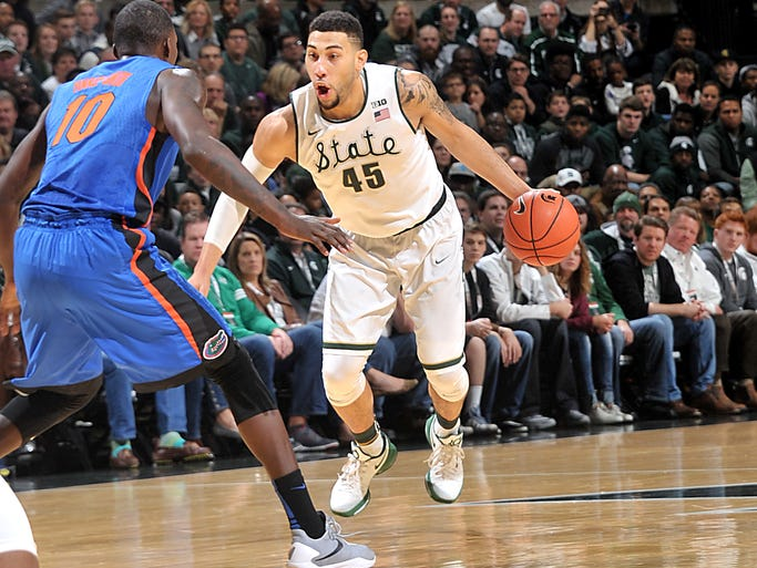 Michigan State's Denzel Valentine drives past Florida's