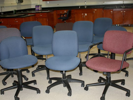 An assortment of used chairs are for sale from Farmington