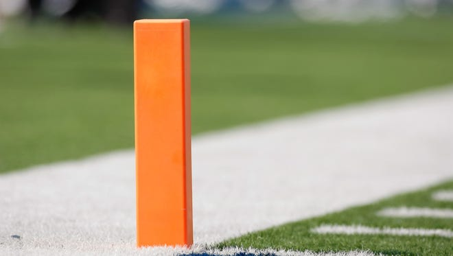 General view of a pylon on a college football field.