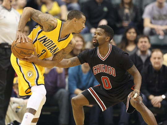 Mar 6, 2015; Indianapolis, IN, USA; Indiana Pacers guard George Hill (3) is guarded by Chicago Bulls guard Aaron Brooks (0) at Bankers Life Fieldhouse. Mandatory Credit: Brian Spurlock-USA TODAY Sports