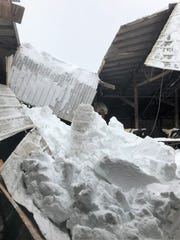 The second roof cave-in from heavy snow is seen in this picture from Sievert Dairy Farm, Sobieski, on the afternoon of April 15.