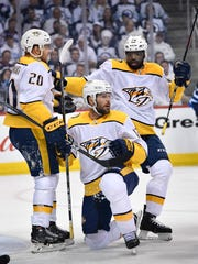 Nashville Predators right wing Miikka Salomaki (20) and defenseman P.K. Subban (76) congratulate center Mike Fisher (12) after his goal against the Winnipeg Jets during the first period of Game 3 in the second-round NHL Stanley Cup playoff series at Bell MTS Place in Winnipeg, Manitoba, Canada, Tuesday, May 1, 2018.