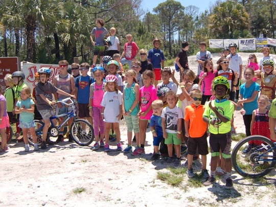 Take A Kid Mountain Biking Day participants are ready to go for guided trail rides in Jonathan Dickinson State Park. This year's event is set for April 28.