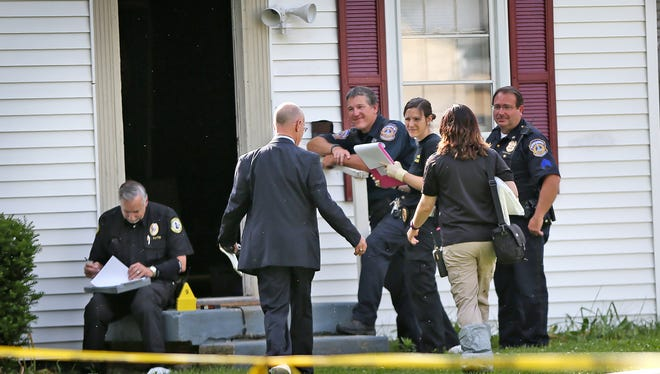 IMPD homicide Detective Bob Flack and the coroner arrived as investigators worked at the scene in the 700 block of South Bosart Avenue, where an intruder was fatally shot by homeowners Tuesday, May 31, 2016.