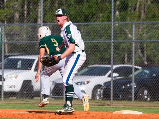 First baseman Colin Breuer (24) of Seacrest yells in excitement after getting the third out and winning the Class 2A regional semifinal against Keswick Christian at Seacrest Country Day School in Naples on Wednesday, May 9, 2018.