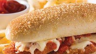 Italian Meatball Sandwich: Sicilian meatballs with Alfredo and marinara served on the signature breadstick bun.