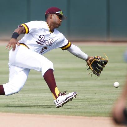 ASU junior second baseman Taylor Lane (47) dives for