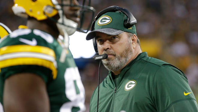 Green Bay Packers coach Mike McCarthy looks on duing their preseason game against the Cleveland Browns last August.