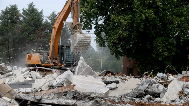 Demo Plus crews knock down buildings at the former Franklin Heights public housing complex on Tuesday, Sept. 19, 2017.