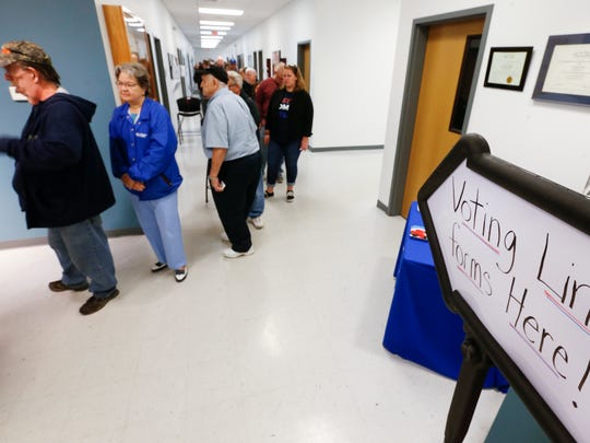 A long line formed at Vatterott College just before the polls opened on Tuesday, November 8, 2016.