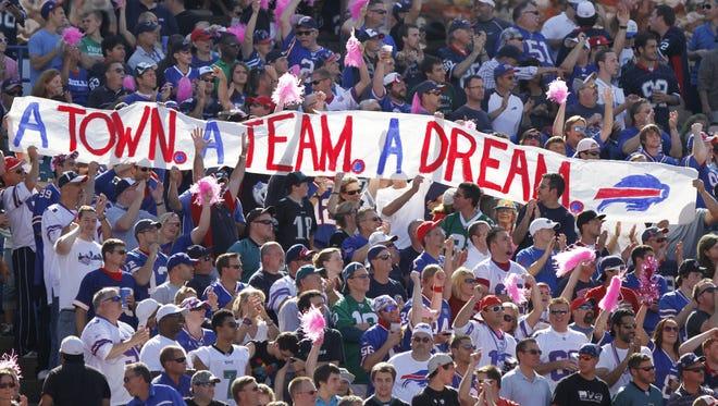 Bills fans show their support as they pack Ralph Wilson Stadium.