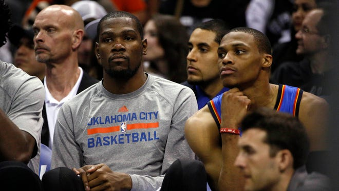 Thunder stars Kevin Durant and Russell Westbrook are not happy during a Game 2 blowout loss to the Spurs.