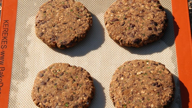 Black Bean-Porcini Mushroom Burgers can be baked or grilled.