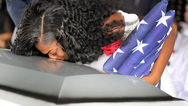 Myeshia Johnson, the widow of Army Sgt. La David Johnson, kisses her husband's casket during the funeral service Saturday at the Hollywood Memorial Gardens in Hollywood, Fla. Mike Stocker, AP Myeshia Johnson, the widow of Army Sgt. La David Johnson, kisses her husband's casket during the funeral service at the Hollywood Memorial Gardens in Hollywood, Fla., on Oct. 21, 2017. Sgt. Johnson was killed with three other colleagues in an ambush by extremists in Niger on Oct. 4.