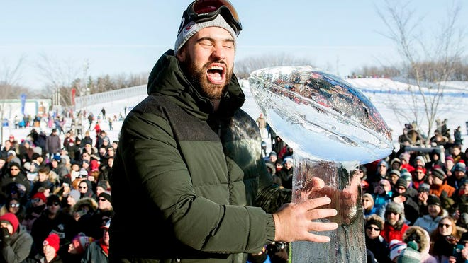 From Feb. 9, 2020, Super Bowl champion and Kansas City Chiefs player Laurent Duvernay-Tardif reacts next to an ice sculpture of the Vince Lombardi Trophy during an event to celebrate his win in Montreal. Duvernay-Tardif has gone from the offensive line to the front line, using the medical degree he completed during offseasons with the Super Bowl champion Chiefs to help patients during the COVID-19 pandemic.