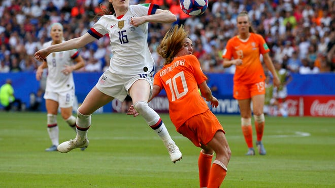 From July 7, 2019, United States' Rose Lavelle, left, is challenged by Netherlands' Danielle Van De Donk during the Women's World Cup final soccer at the Stade de Lyon in Decines, outside Lyon, France. Twenty players have been named to the U.S. women's soccer team that will play for a spot in the Tokyo Olympics. Coach Andonovski announced the roster for the CONCACAF Olympic qualifying tournament Friday, Jan. 17, 2020.