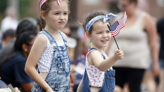 Sisters Kenna, 6, and Madi Simms, 4, of Pickerington enjoy the festivities during the 2019 Fourth of July parade in Pickerington. City officials said because of COVID-19 coronavirus pandemic concerns, the parade and festivities in Victory Park have been canceled, They said they remain hopeful an abbreviated fireworks display might be offered.