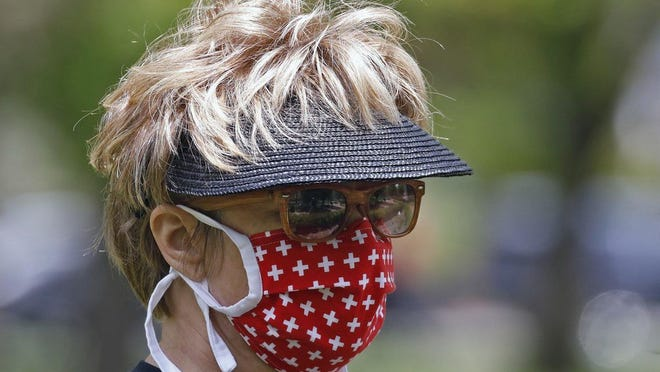 Several Ohio communities are requiring the wearing of a facial coverings inside buildings and in crowds outside.