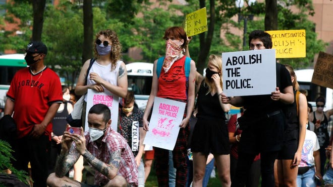 Before the Providence City Council Finance Committee met to discuss defunding the Police Department, protesters and community groups rallied in Burnside Park in Providence, near City Hall.