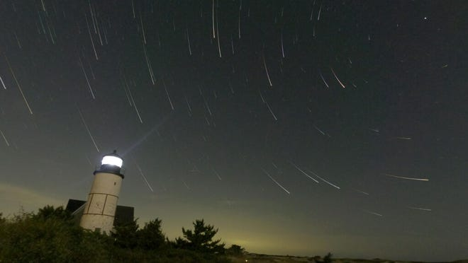Sandy Neck Light shines up towards the North Star in this time exposure star trail image.