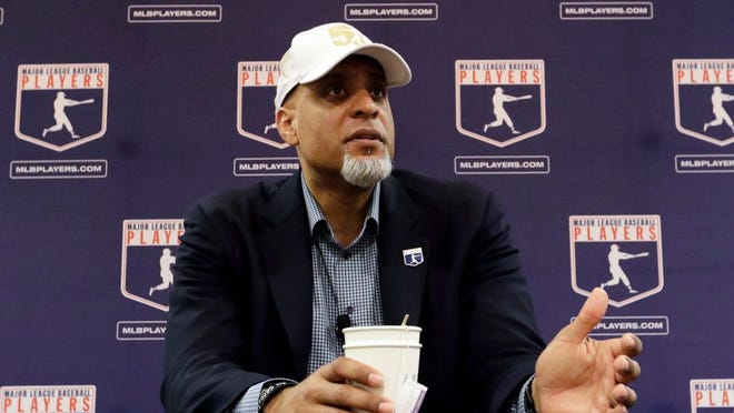 In this Feb. 19, 2017, file photo, Major League Players Association Executive Director Tony Clark, answers questions at a news conference in Phoenix.