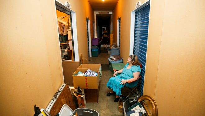 Stayton resident Renae Winters sits in the hallway outside of her storage unit in Stayton on Tuesday, June 20, 2017. Winters was eventually able to get rid of the storage unit, after deciding which items to keep, which to throw away, and which to donate or sell.