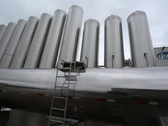 Stainless steel tanks tower over a milk semi truck at Grassland Dairy Products near Greenwood. Wisconsin's role as a major milk-producing state has profound implications for the prices dairy farmers get for their product.
