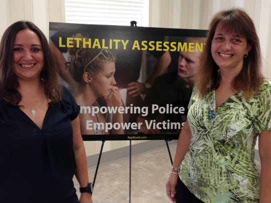 Alecia Armold, left, and Karen Kuykendall Nordsick attend a press conference Aug. 8, 2017, by state Rep. Kate Klunk, R-Hanover, who urged the passage of House Bill 175, which would require all Pennsylvania police departments to use the Lethality Assessment Program (LAP) in PA, Tuesday, Aug. 8, 2017.  Armold's mother, Barb Schrum, and Nordsick's sister, Laurie Kuykendall, were murdered by Laurie's estranged husband in 2015.  (Liz Evans Scolforo photo)