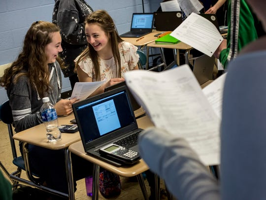 Hanna Badke, right, and Emma Washburn, both 17, work together on an assignment in Amanda Volz's classroom Wednesday, March 22, 2017 at St. Clair High School.