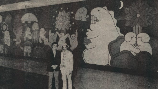 "This photograph, printed in 1979 in a Pekin Daily Times tabloid insert, shows the former Pekin Mall's entrance mural, ""The Garden of Earthly Delights,"" with the artist, Ken Munowitz of New York (right), and Herb Simon (left), president of Melvin Simon & Associates, developers of the Pekin Mall."