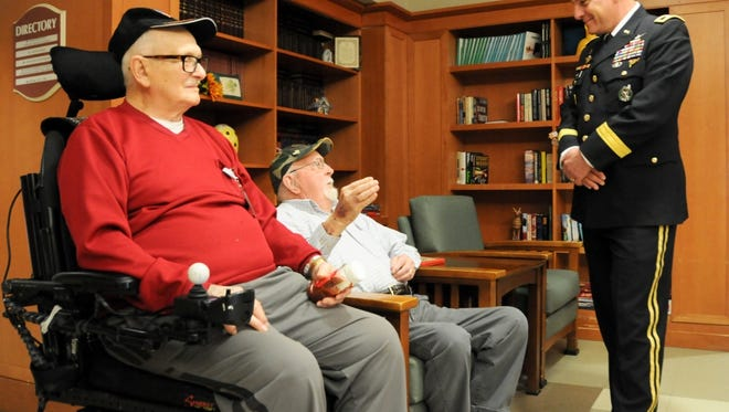 Maj. Gen. Troy D. Kok, commanding general of the U.S. Army Reserve's 99th Regional Support Command headquartered at Joint Base McGuire-Dix-Lakehurst, meets with (from left) George A. Teale, an Army private who served in World War II, and Larry H. Stange, a Marine sergeant who served in Korea, during a Jan. 28 visit to the New Jersey Department of Military and Veterans Affairs' New Jersey Veterans Memorial Home in Vineland. The purpose of Kok's visit was to thank veterans for their service and encourage young soldiers to spend time with veterans in their local area.