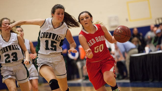 Jessica Wilkinson drives past Cornwall's Olivia Davet during the Section 9 Class A championship game at Mount Saint Mary College in Newburgh on March 5.