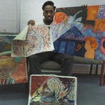Amad Redding, or Amad Rashad, as he is known to those who view his art, displays some of his work. He decided to focus on art after leaving the Southern University track team.