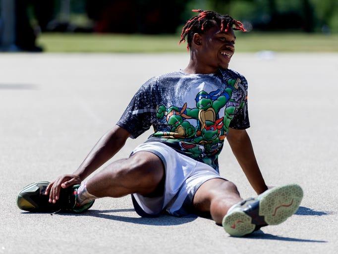 Da'Breion Ferguson Toombs smiles while  stretching