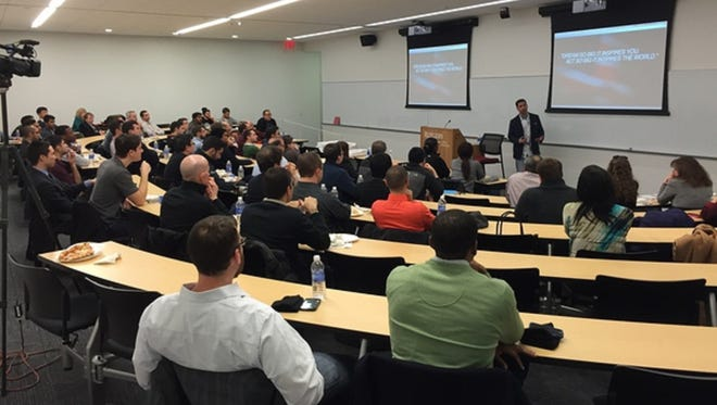 """Self-help expert Croix Sather kicks off Scarlet Startups' """"How to Become a Champion in Business and Life"""" to a packed room of students and alumni at the Business School on Rutgers University."""