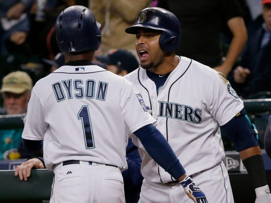 Mariners' Nelson Cruz, right, celebrates with Jarrod Dyson after Dyson scored in the sixth inning against the Tigers, June 21, 2017 in Seattle.